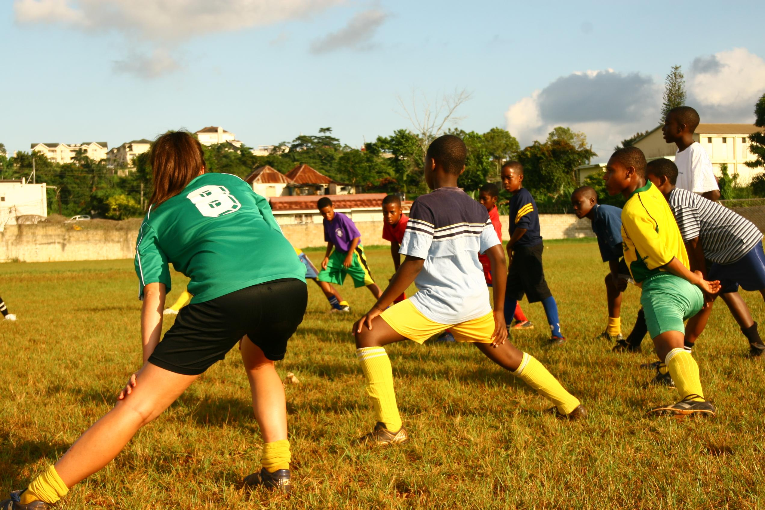 A volunteer taking football classes gains sports coaching work experience in Jamaica